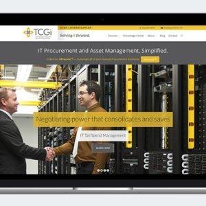 TCGi website on laptop