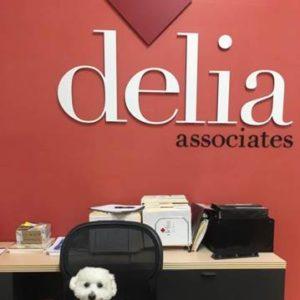 Jeter sitting in front of Delia Associates logo