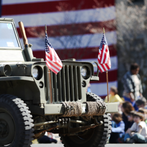 Jeep in front of Flag