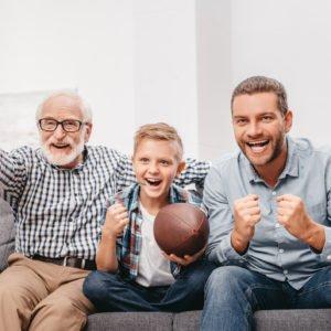 Family watching football at home