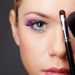 Woman behind makup brushes